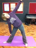 Here the student needs to take her head upwards and backwards in the Triangle pose